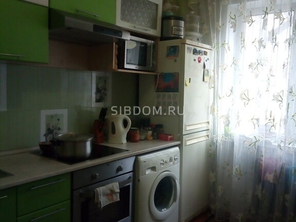 Продам 2-комнатную, 51 м², Юрина ул, 309. Фото 1.
